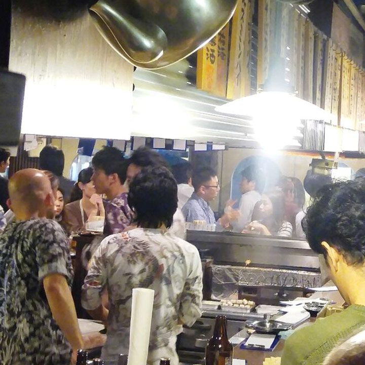 Marugin bar in Tokyo. Packed with guests and brightly lit