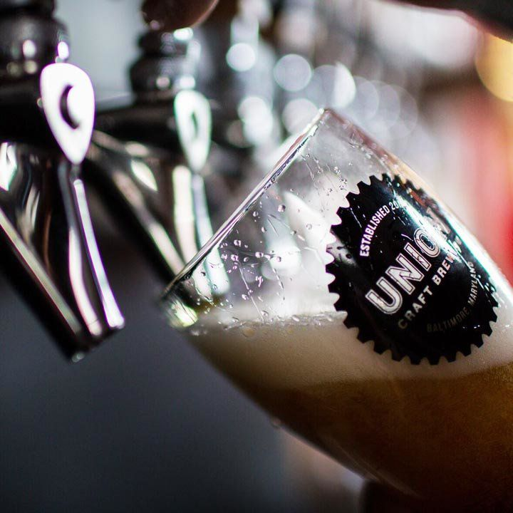 A pint being poured at Union Craft Brewing in Baltimore