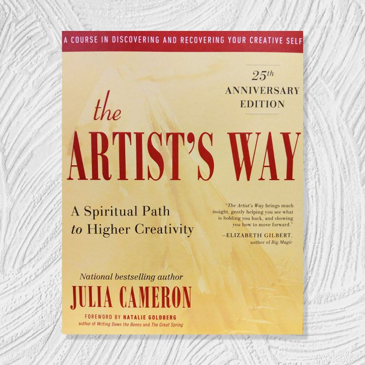 The Artist's Way cover, soft yellow background with burgundy, black, and white text and accents