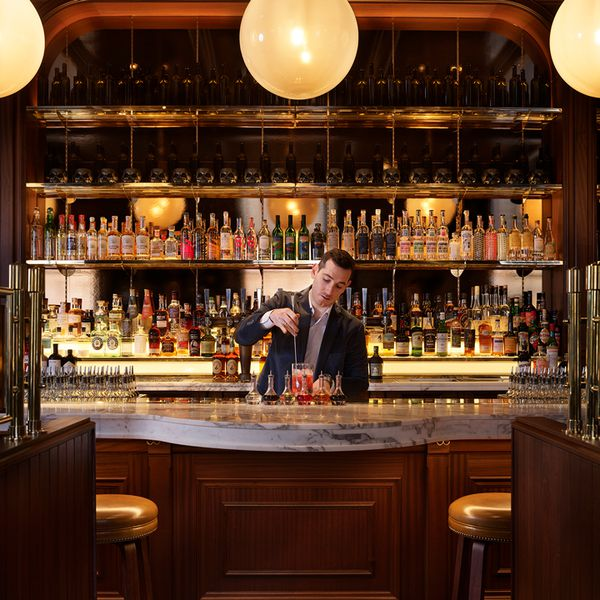 Bar director Pietro Collina stirs a cocktail at Side Hustle in London.