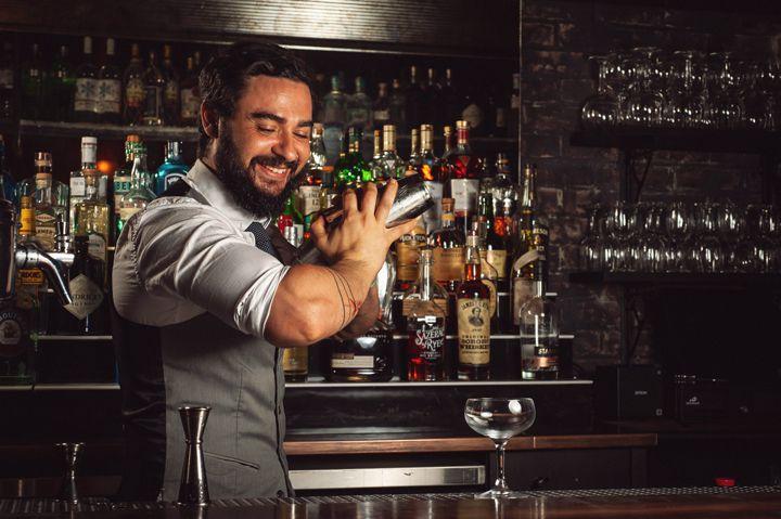 Brendan Bartley shakes a cocktail at Bathtub Gin in NYC.
