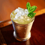 Gin on Gin Julep in a julep mug with crushed ice and a mint sprig garnish
