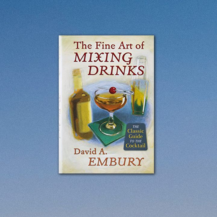 The Fine Art of Mixing Drinks reprint cover featuring a vintage-inspired illustration of a bottle, a Manhattan served up on a green napkin, and a shaker. Font is also vintage and burgundy and dark orange in color. Cover is set against blue gradient composite frame