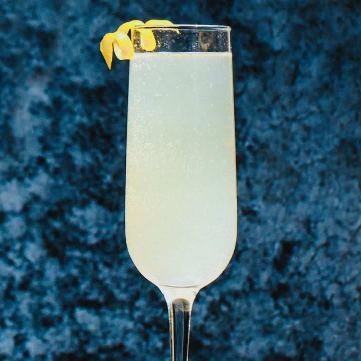 French 75 cocktail in a flute with a lemon twist