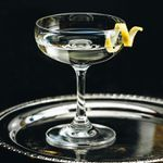vesper cocktail with a lemon twist, served on a silver tray