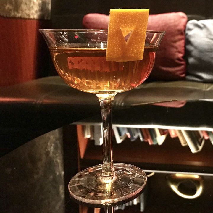 Better Half cocktail in a coupe glass with a rectangular orange peel garnish