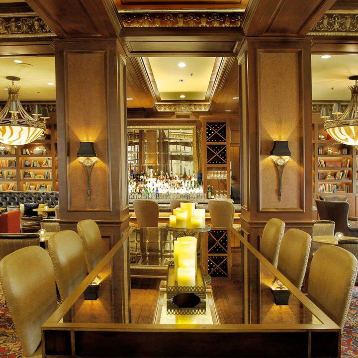 The Library bar interior. High padded chairs and modern sconces abound