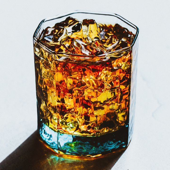 Stinger cocktail in a rocks glass against a white background