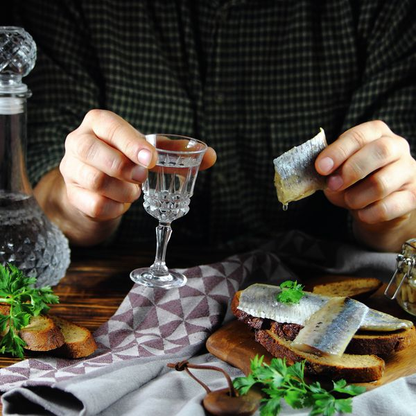 Russian meal of pickled herring and vodka