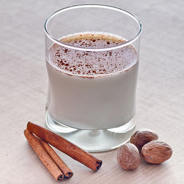 spiced rum milk punch with cinnamon sticks and nutmeg